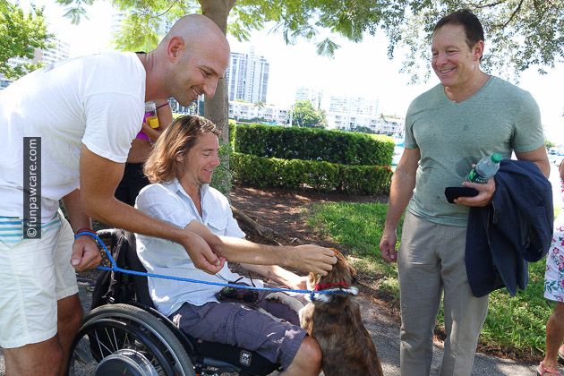 Russell Hartstein and Steve Guttenberg with man in wheel chair