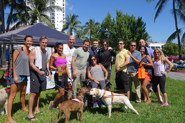 Group photo at service dog and homeless dog event with Fun Paw Care